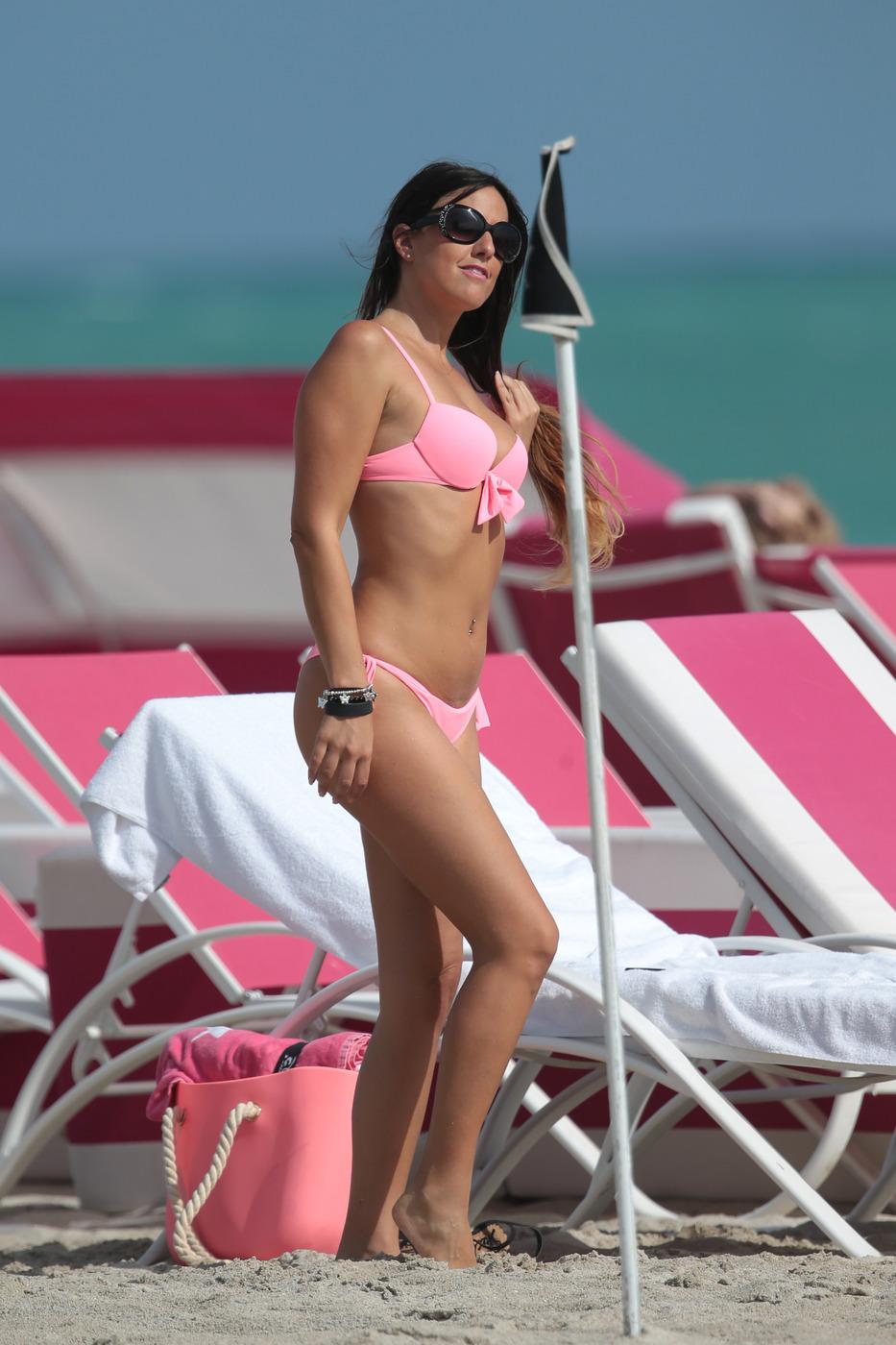 Italian model Claudia Romani wears a pink bikini to the beach in Miami