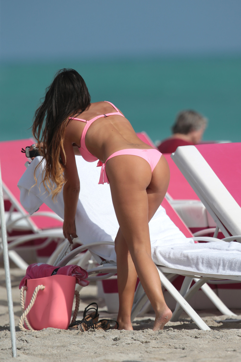 Italian model Claudia Romani wears a pink bikini to the beach in Miami