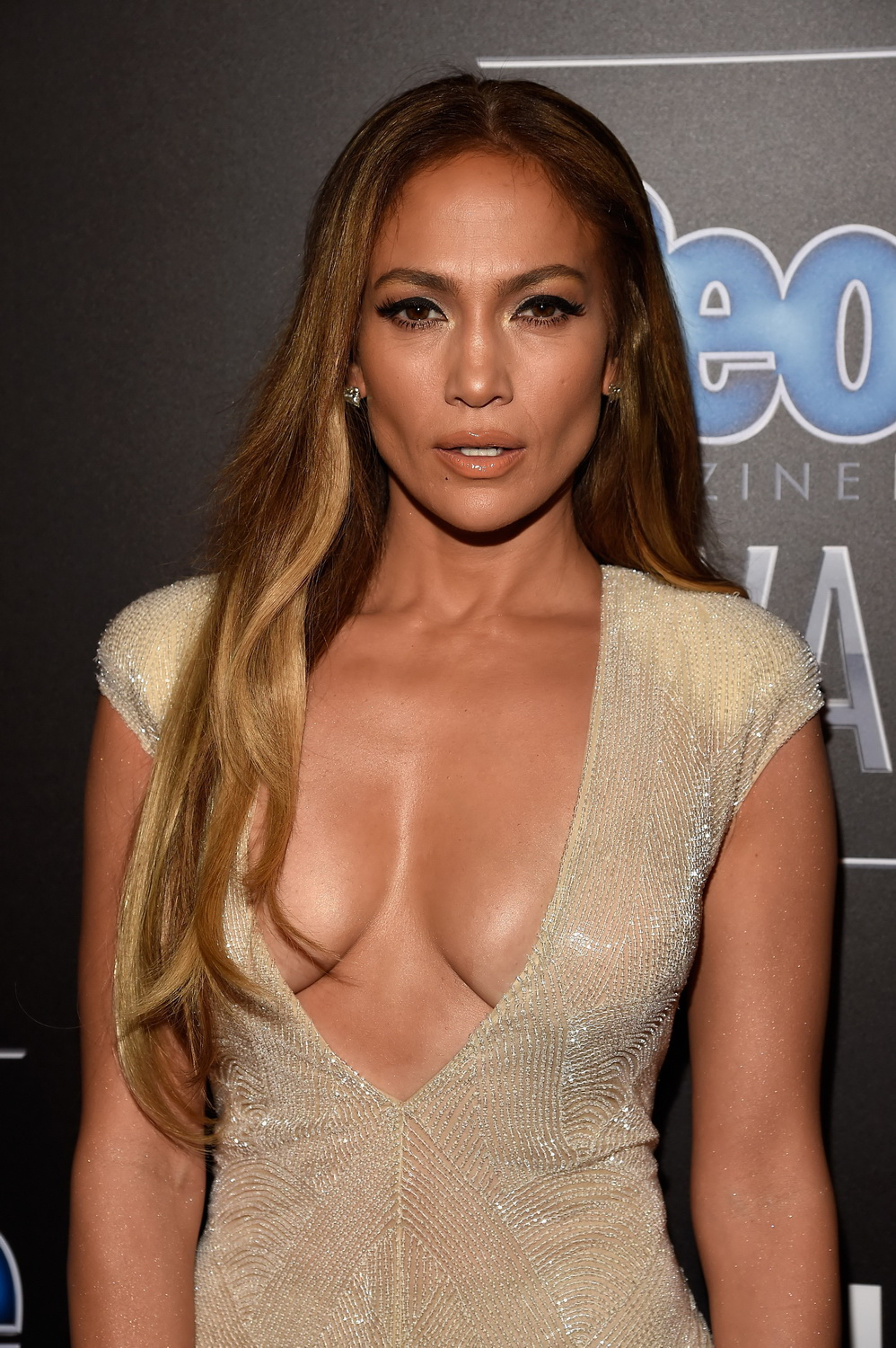 jennifer-lopez-deep-cleavage-at-the-people-magazine-awards-8.jpg