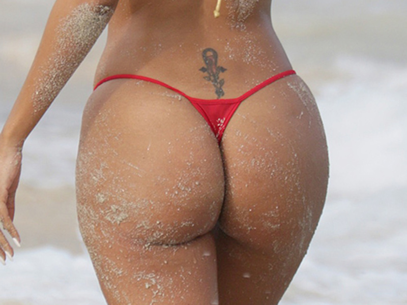 Aisha Thalia in a thong bikini at the beach in Miami
