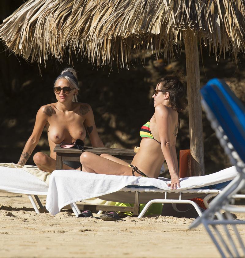 lou-teasdale-topless-sunbathing-1