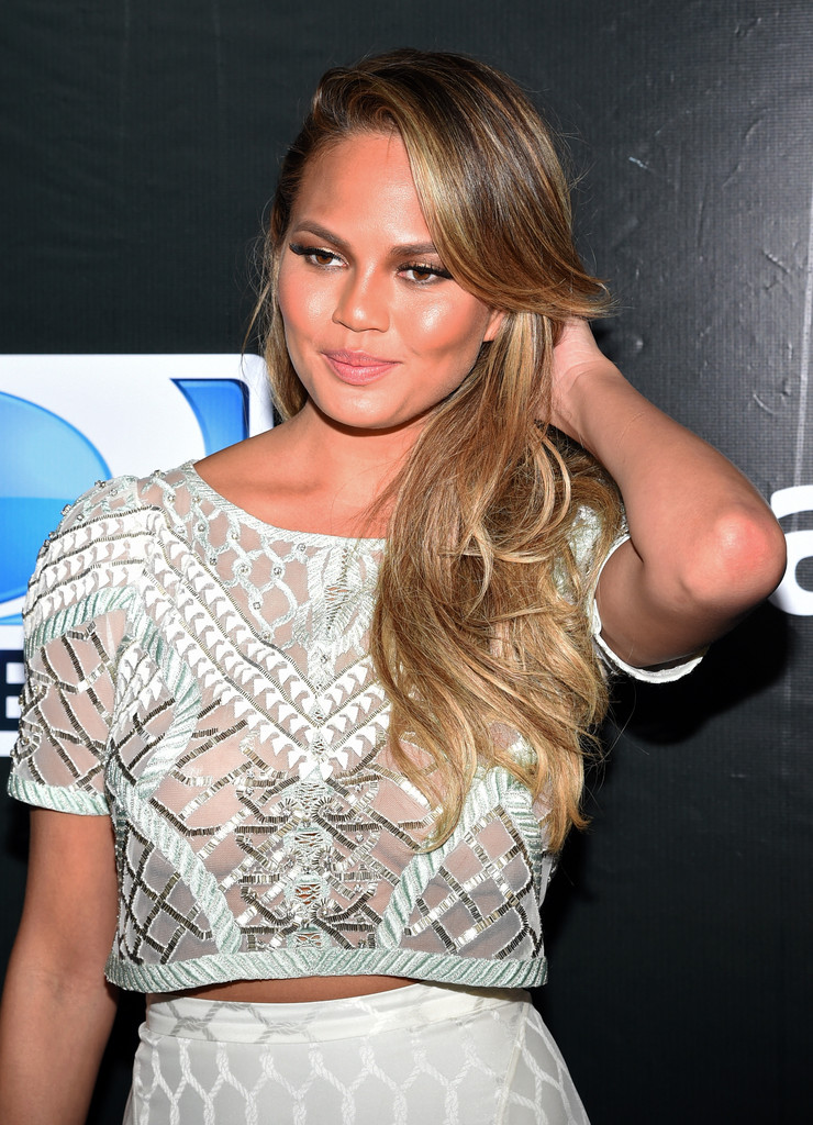 chrissy-teigen-see-through-directv-4