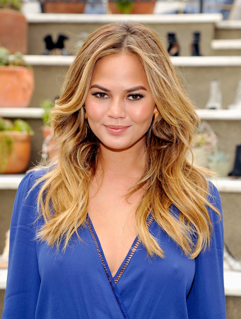 chrissy-teigen-nipple-pokes-raye-show-launch-event-6