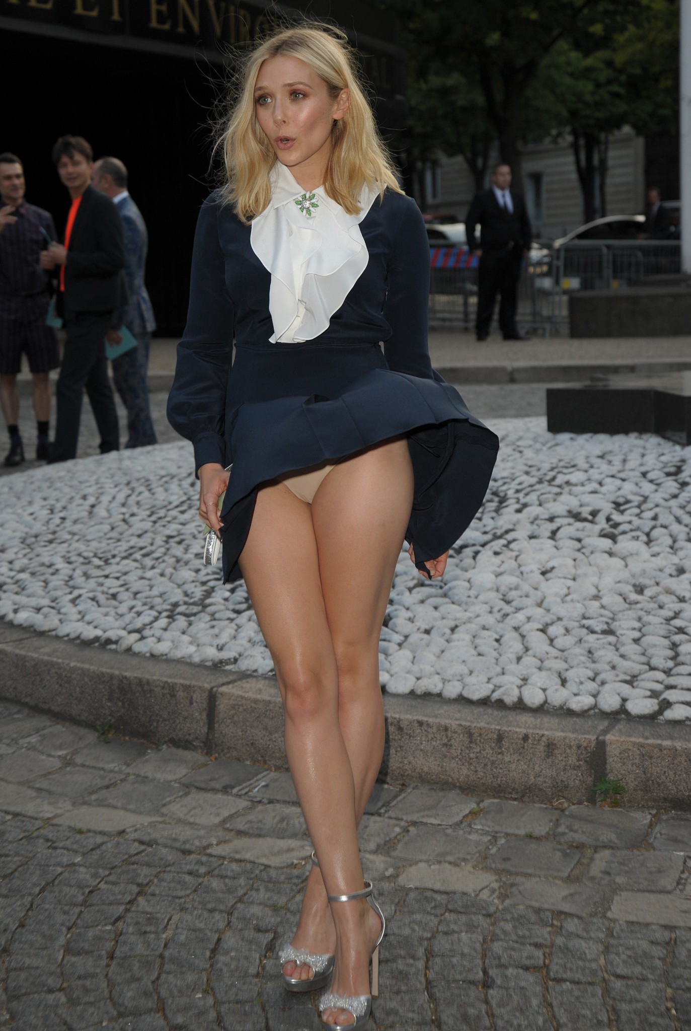 elizabeth olsen wind blown upskirt at miu miu fragrance and