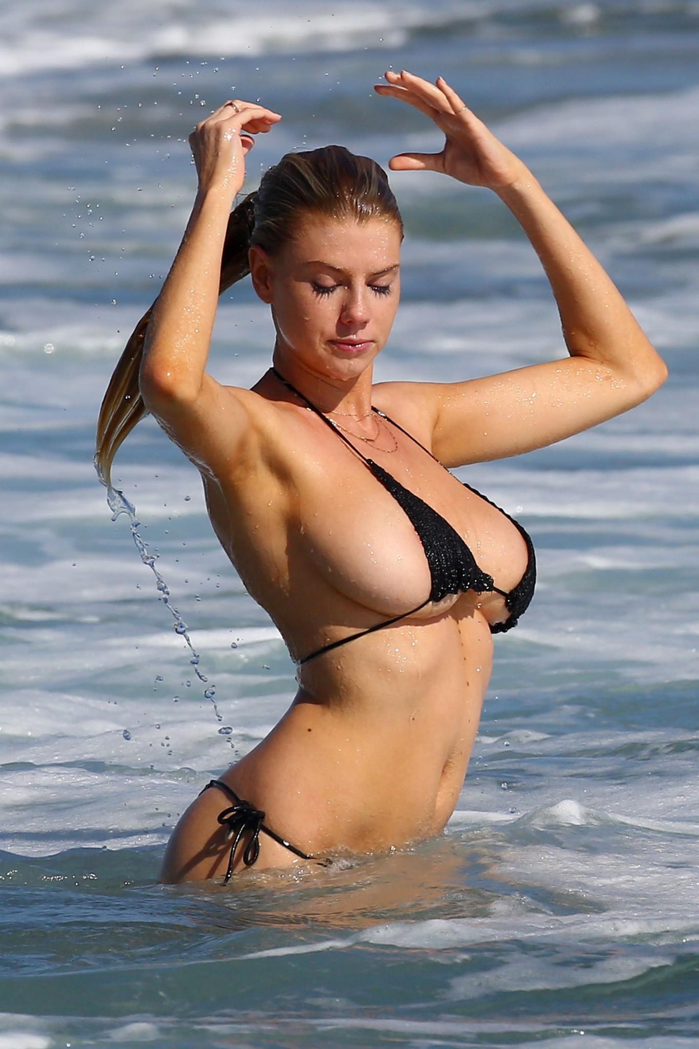 Charlotte McKinney Wearing A Thong Bikini And A Couple Of ...
