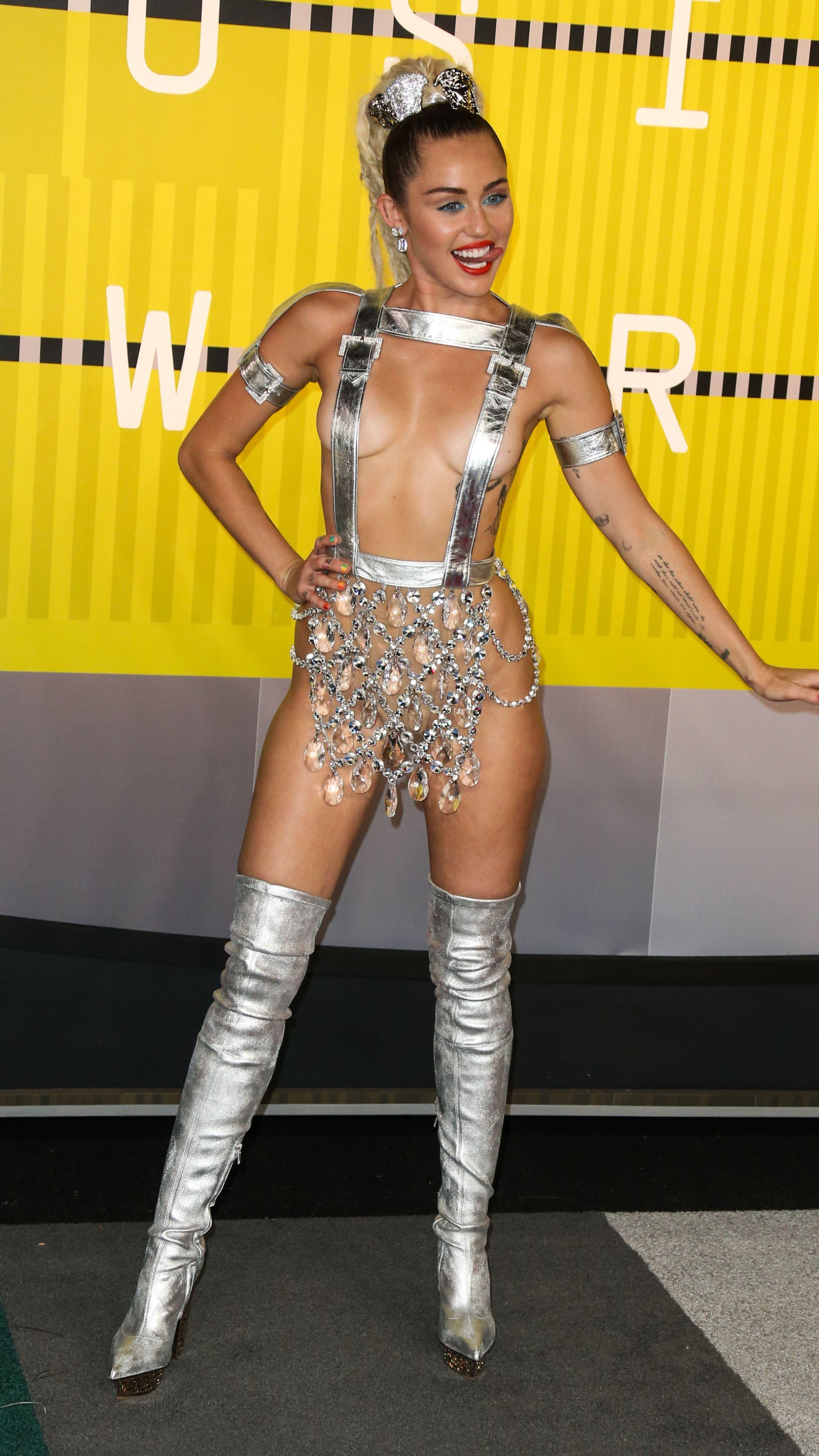 Miley cirus half naked pics