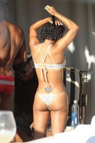 christina-milian-wearing-a-bikini-areola-slip-in-miami-07