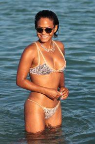 christina-milian-wearing-a-bikini-areola-slip-in-miami-14