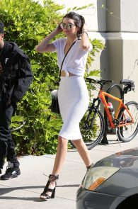 kendall-jenner-braless-in-see-through-white-top-at-cinepolis-theater-01