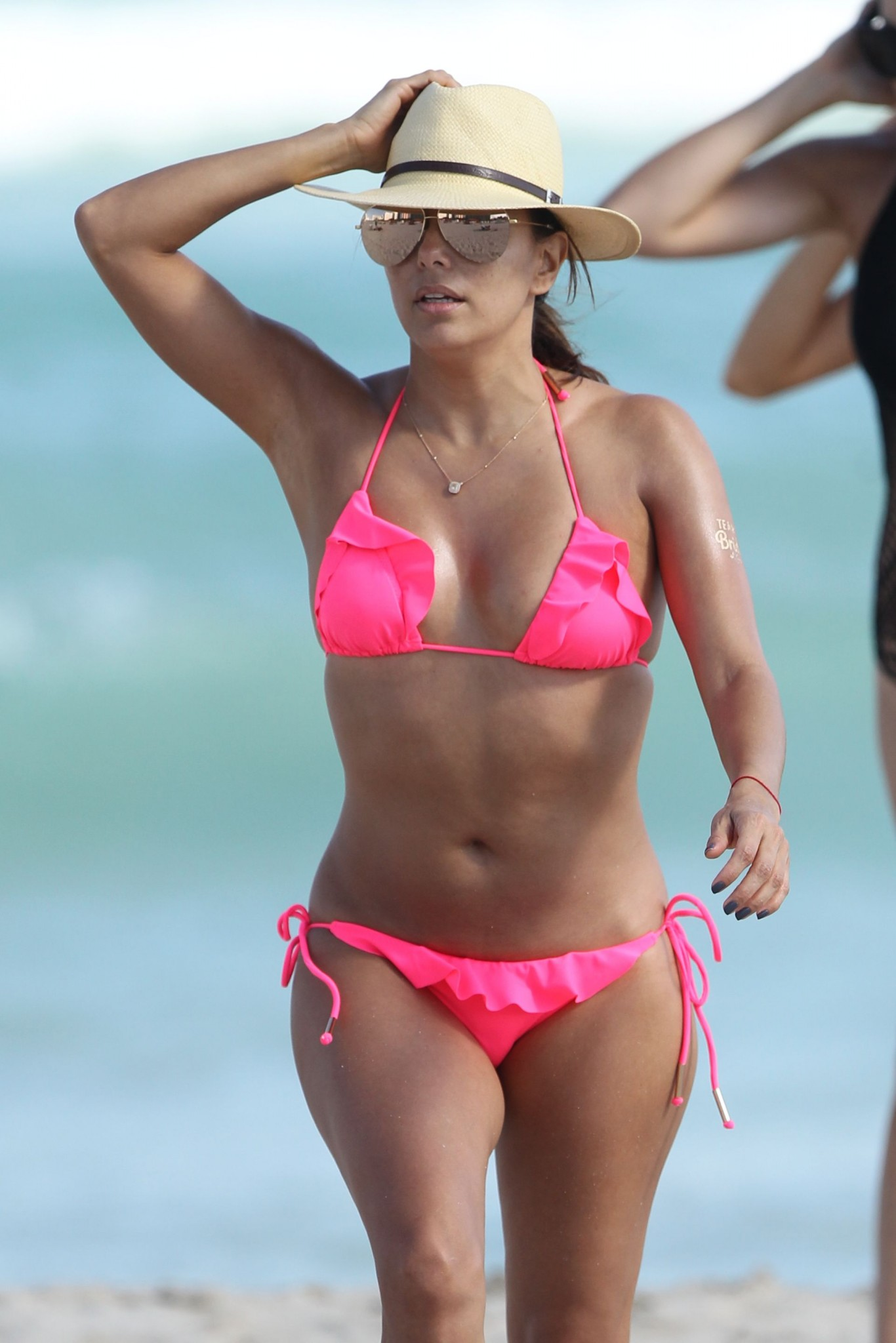 eva-longoria-wearing-a-pink-bikini-in-miami-20