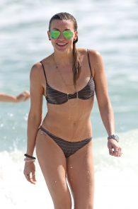 katie-cassidy-wearing-a-black-bikini-in-miami-04