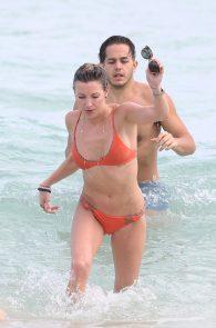 katie-cassidy-wearing-an-orange-color-thong-bikini-in-miami-01