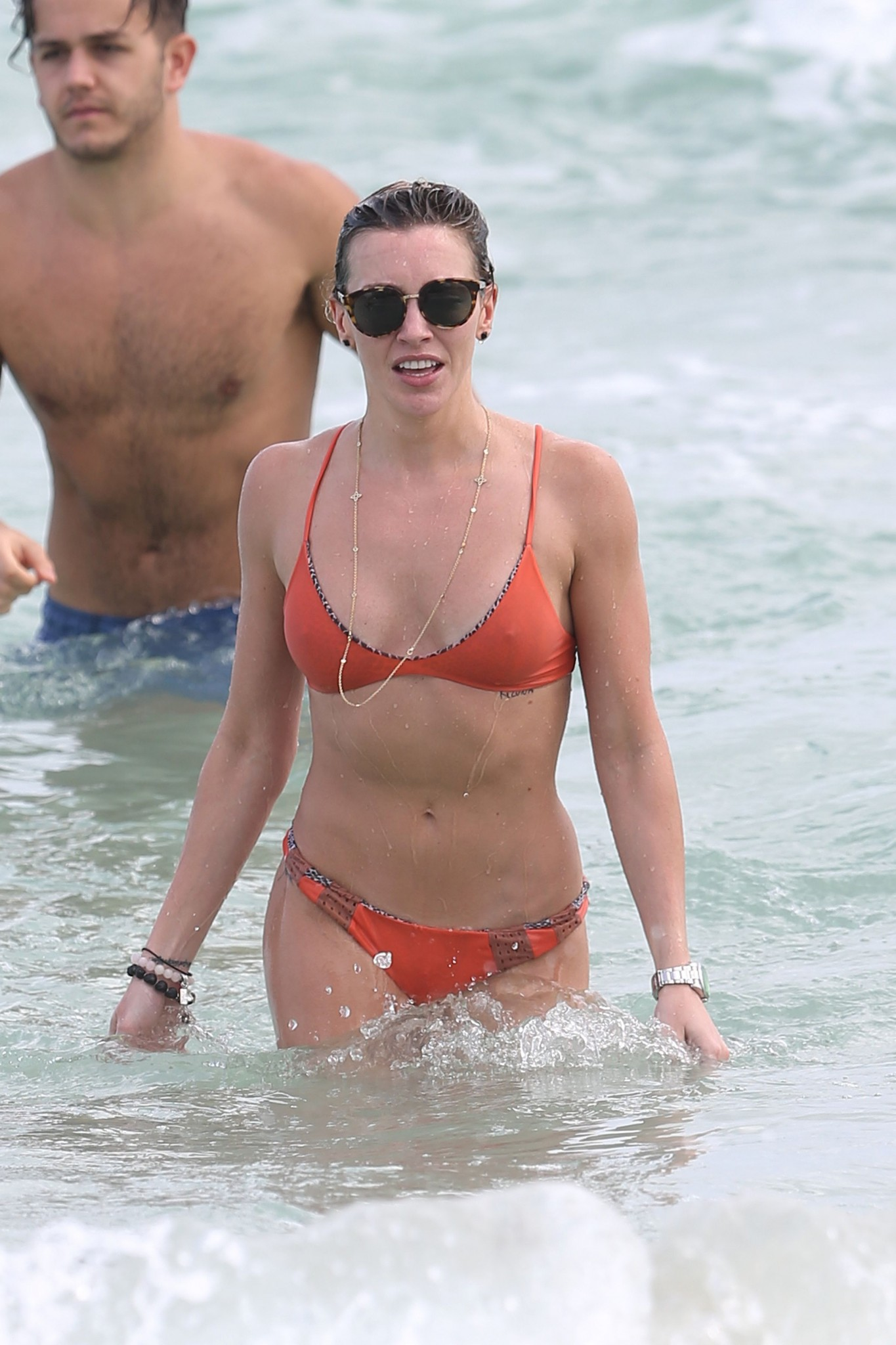 katie-cassidy-wearing-an-orange-color-thong-bikini-in-miami-04