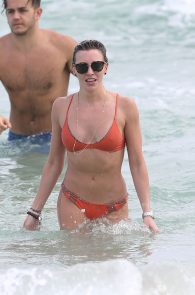 katie-cassidy-wearing-an-orange-color-thong-bikini-in-miami-04