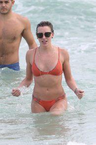 katie-cassidy-wearing-an-orange-color-thong-bikini-in-miami-06