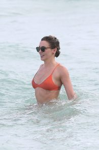 katie-cassidy-wearing-an-orange-color-thong-bikini-in-miami-07