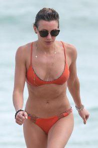 katie-cassidy-wearing-an-orange-color-thong-bikini-in-miami-09