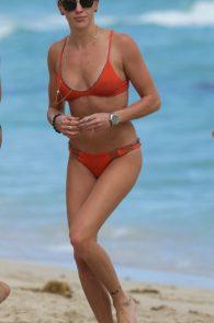 katie-cassidy-wearing-an-orange-color-thong-bikini-in-miami-12