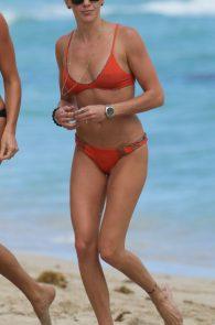 katie-cassidy-wearing-an-orange-color-thong-bikini-in-miami-13