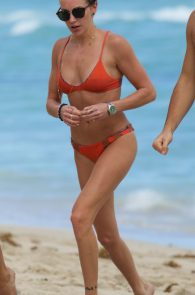 katie-cassidy-wearing-an-orange-color-thong-bikini-in-miami-16