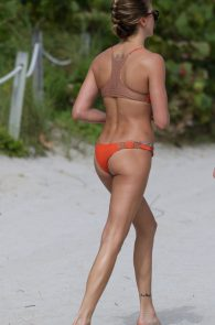 katie-cassidy-wearing-an-orange-color-thong-bikini-in-miami-17