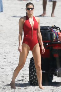 alexandra-daddario-red-bikini-on-set-of-baywatch-in-tybee-01