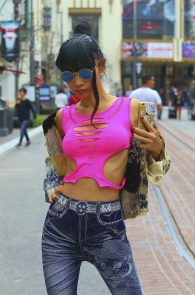 bai-ling-braless-nipple-pokes-while-shopping-04
