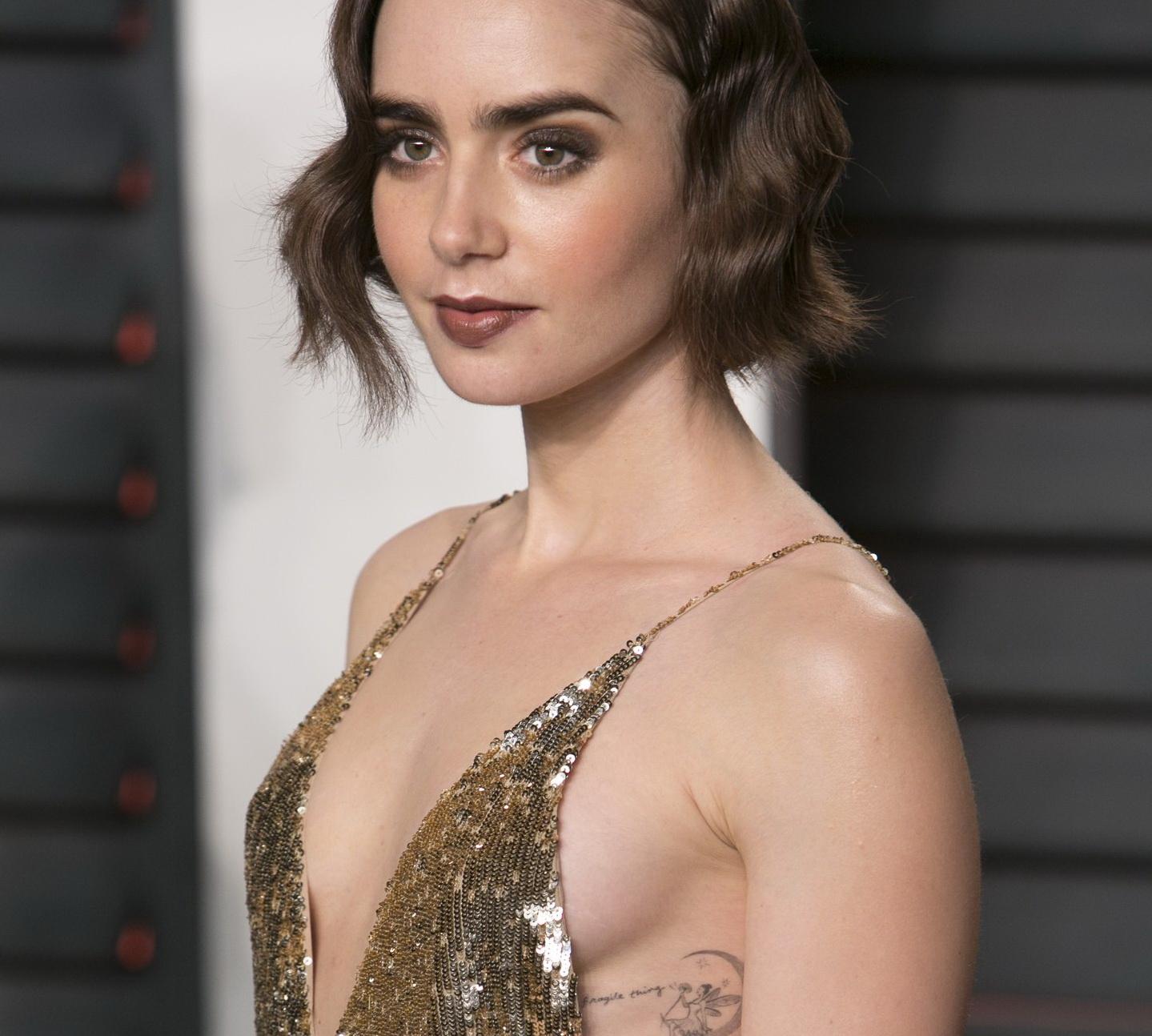 lily-collins-sideboob-at-2016-vanity-fair-oscar-party-09