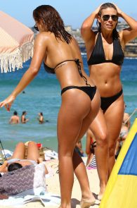 natasha-oakley-and-devin-brugman-wearing-black-bikinis-on-mondi-beach-13