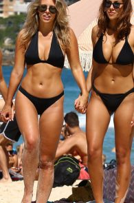natasha-oakley-and-devin-brugman-wearing-black-bikinis-on-mondi-beach-33