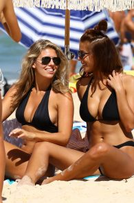 natasha-oakley-and-devin-brugman-wearing-black-bikinis-on-mondi-beach-35