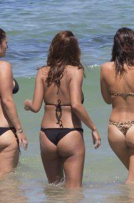 natasha-oakley-and-devin-brugman-wearing-black-bikinis-on-mondi-beach-42