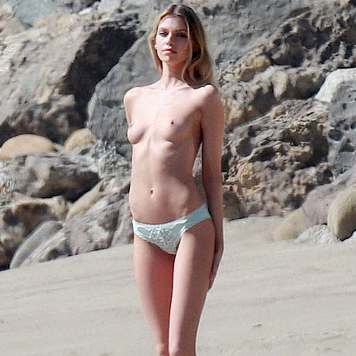 stella-maxwell-topless-on-the-beach-in-malibu-03