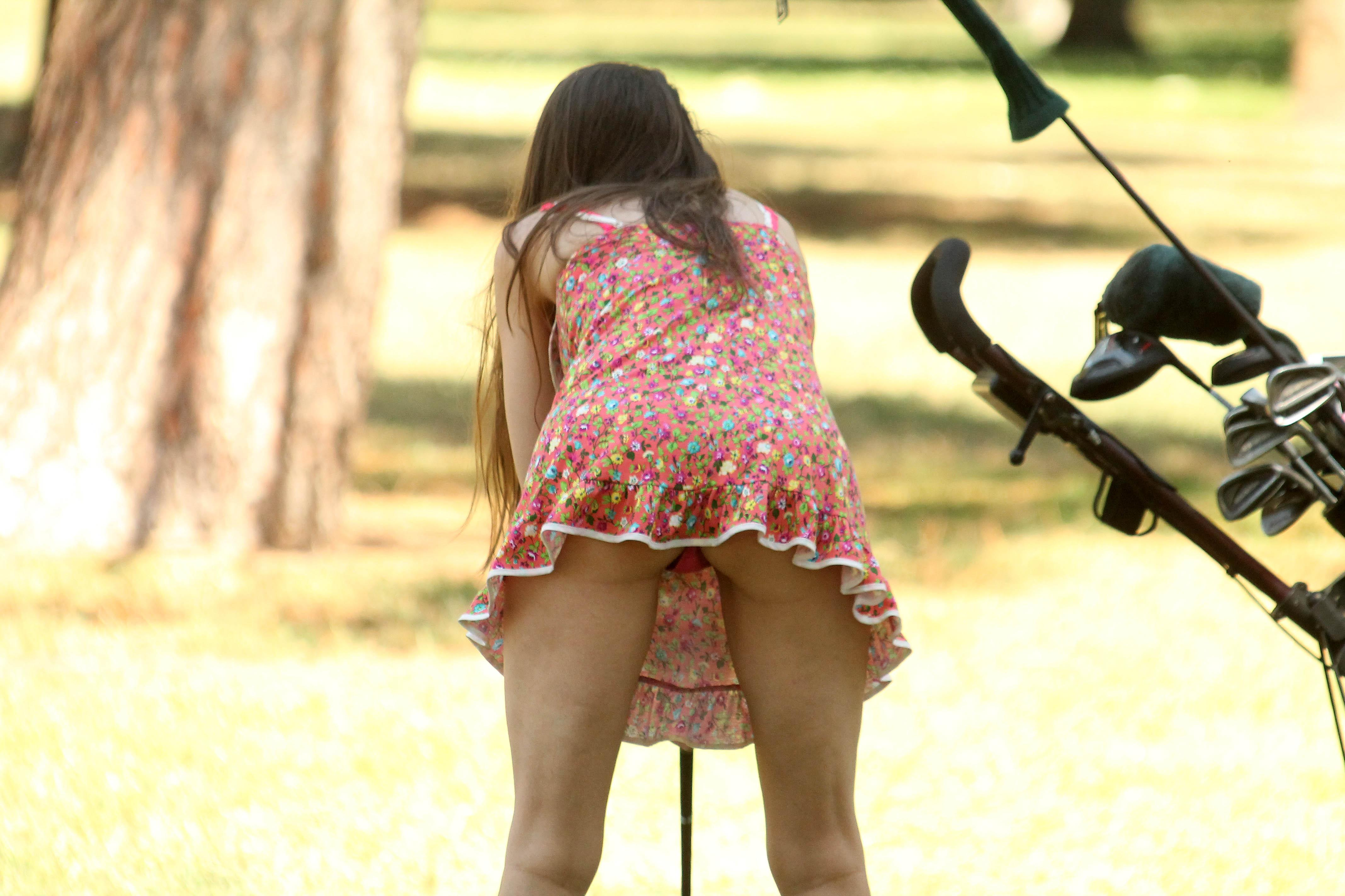 Young solo girl flashes her upskirt panties while climbing a rock  1877613