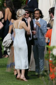 jennifer-lawrence-braless-pokies-at-a-wedding-in-italy-02