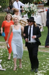 jennifer-lawrence-braless-pokies-at-a-wedding-in-italy-05