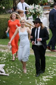 jennifer-lawrence-braless-pokies-at-a-wedding-in-italy-06