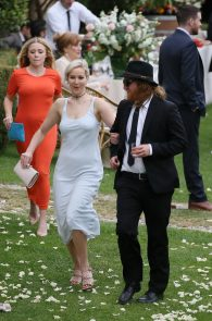 jennifer-lawrence-braless-pokies-at-a-wedding-in-italy-07
