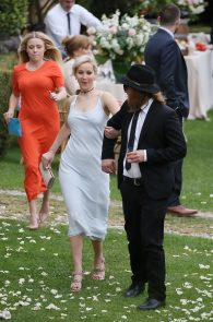jennifer-lawrence-braless-pokies-at-a-wedding-in-italy-08