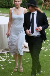 jennifer-lawrence-braless-pokies-at-a-wedding-in-italy-11