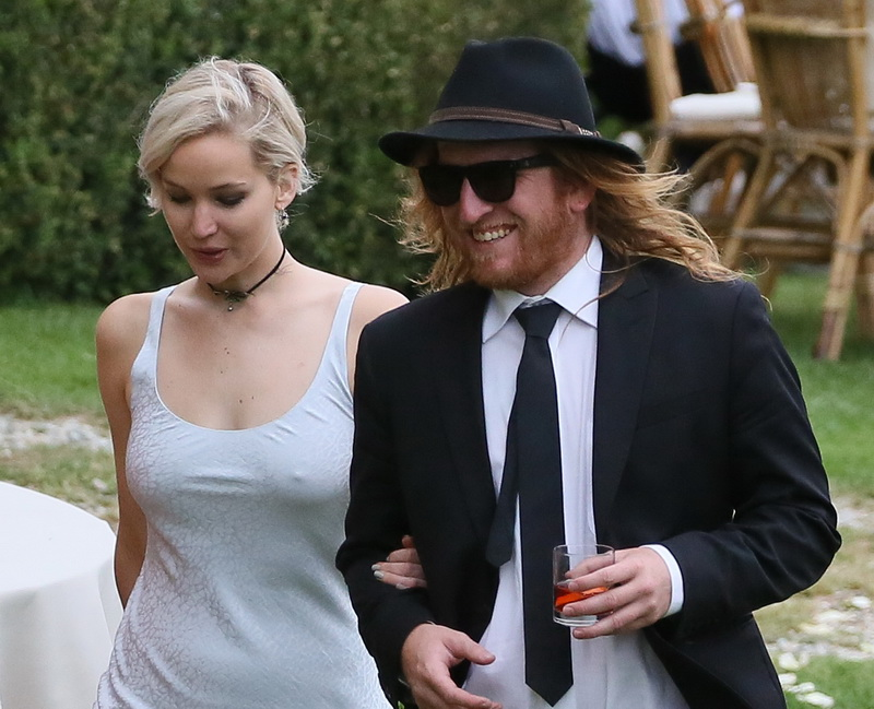 jennifer-lawrence-braless-pokies-at-a-wedding-in-italy-14