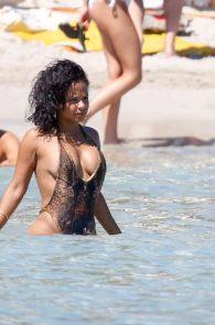 christina-milian-swimsuit-nipple-slip-in-ibiza-03