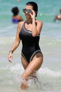 kourtney-kardashian-black-swimsuit-in-miami-01
