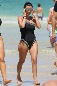 kourtney-kardashian-black-swimsuit-in-miami-12