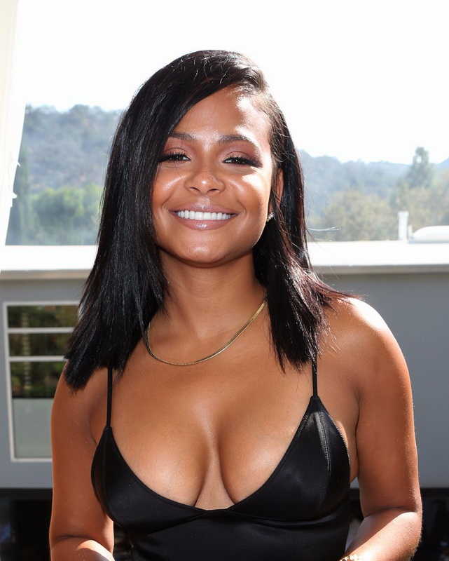 christina-milian-braless-deep-cleavage-at-a-pool-party-21