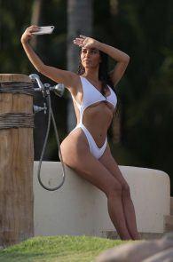 kim-kardashian-wet-shirt-bikini-on-a-beach-in-mexico-02