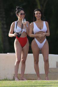 kim-kardashian-wet-shirt-bikini-on-a-beach-in-mexico-03