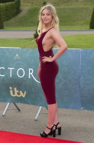 nell-hudson-sideboob-at-victoria-premiere-in-london-06