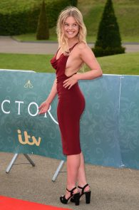 nell-hudson-sideboob-at-victoria-premiere-in-london-17
