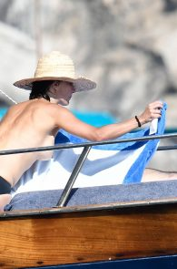 sophie-marceau-topless-on-a-yacht-in-capri-03